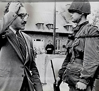 1970 FILE PHOTO - ARCHIVES -<br /> <br /> Arrested in police raids today. Quebec labor leader Michel Chartrand was among scores of people believed sympathetic to FLQ cause rounded up in Montreal. Yesterday (above) he stood scratching his head in mock amazement as troops poured into Montreal to take up guard duties in advance of the police raids in which Chartrand was picked up. He had publicly endorsed the FLQ manifesto.<br /> <br /> 1970<br /> <br /> PHOTO : Graham Bezant - Toronto Star Archives - AQP