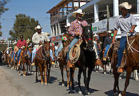 CABALLEROS or Mexican cowboys ride into town for the festival of the VIRGIN OF GUADALUPE - LOS RODRIGUEZ, GUANAJUATO, MEXICO