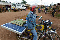 TANZANIA, Tarime, transport of PV solar panel by motorbike / Transport eines Solar Panels mit dem Motorrad