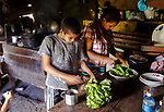 Rosita and her nephew preparing our salad in the kitchen - the lettuce was harvested from their nearby plot.