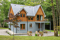 BNPS.co.uk (01202) 558833. <br /> Pic: Bidwells/BNPS<br /> <br /> Pictured: The two-bedroom cottage.<br /> <br /> Better than a gravy boat...<br /> <br /> A striking country house built by a bishop as a wedding gift for his son is on the market for offers over £2m.<br /> <br /> Dunbeg House sits in an incredible position on the bank of a loch with stunning panoramic water and mountain views.<br /> <br /> The impressive property not only includes the five-bedroom main house, but also a two-bedroom cottage that has been run as a successful holiday let and over four acres of woodland garden.