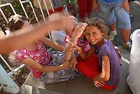 ROMANIA, Babadag, 2010/08/23.A Horahai Roma child in Babadag participates in a summer camp organized by the association Romani Criss aimed to Roma children live with other village children..© Bruno Cogez / Est&Ost Photography..Roumanie, Babadag, 23/08/2010.Une enfant rom Horahai à Babadag participe à une colonnie de vacances organisée par l'association Romani Criss ayant pour but de faire cohabiter des enfants roms avec les autres enfants du village..© Bruno Cogez / Est&Ost Photography