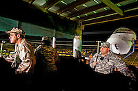 Guards works the night shift in the watchtower of Camp Delta at the American naval base at Guantanamo Bay, where over 600 alleged al Qaeda members have been held indefinitely. Described by the US as 'unlawful enemy combatants', they were captured primarily in Afghanistan during the 'war against terror'.