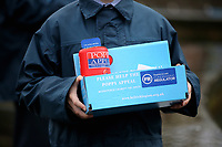 Pictured: A poppy appeal fundraising box. Saturday 11 November 2017<br /> Re: Armistice Day, two minutes were observed to mark remembrance at Castle Square in Swansea, Wales, UK.