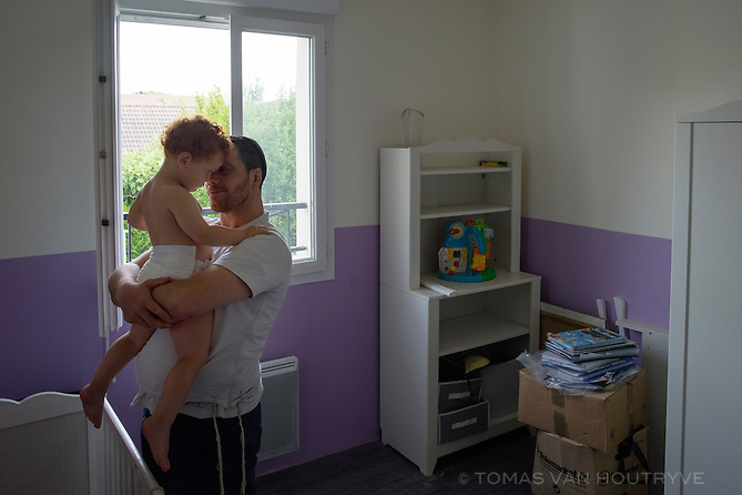 Laurent Haddad holds his two-year-old daughter, Tali, in their home in Villepinte, near Paris, France on 22 July, 2015. Haddad is packing up the family's belongings to move to Israel, a growing trend among Jews in France after a series of terrorist attacks targeting Jews.