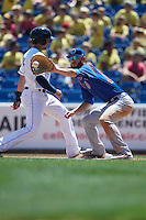 South Bend Cubs first baseman Matt Rose (17) stretches for a pickoff attempt throw as David Armendariz (15) gets back to the bag during a game against the Lake County Captains on July 27, 2016 at Classic Park in Eastlake, Ohio.  Lake County defeated South Bend 5-4.  (Mike Janes/Four Seam Images)