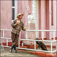 Faces Of Cuba - Breakfast on the run with the town dog waiting for his part.