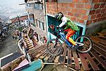 Downhill riders attend a Urban Bike Race at the slum Comuna 1 in Medellin, Colombia