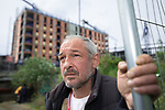 © Joel Goodman - 07973 332324 . 30/04/2017 . Salford, UK . Valeriy (43) , from Lithuania with development behind . Homeless men are living in a towpath tunnel in Saford , in the shadow of the Ordsall Chord railway link and a large , Chinese-backed housing development. Photo credit : Joel Goodman