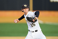 Wake Forest Demon Deacons starting pitcher Jack Fischer (15) delivers a pitch to the plate against the Maryland Terrapins at Wake Forest Baseball Park on April 4, 2014 in Winston-Salem, North Carolina.  The Demon Deacons defeated the Terrapins 6-4.  (Brian Westerholt/Four Seam Images)