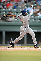 Shortstop Christopher Navarro (11) of the Asheville Tourists bats in a game against the Greenville Drive on Friday, August 23, 2019, at Fluor Field at the West End in Greenville, South Carolina. Greenville won, 11-1. (Tom Priddy/Four Seam Images)