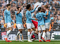 Raheem Sterling of Manchester City scores his 2nd goal and celebrates with his teammates during the FA CUP FINAL match between Manchester City and Watford at Wembley Stadium, London, England on 18 May 2019. Photo by Andy Rowland.