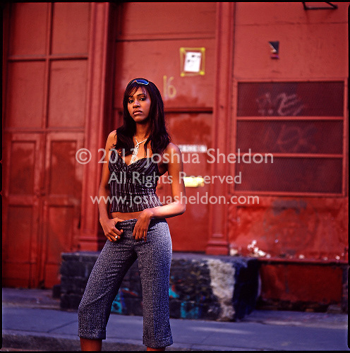 African American girl standing in front of burgandy colored building