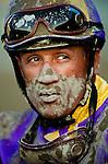 Jockey, David Flores returns from the race covered in dirt at Santa Anita Park, Arcadia California on September 29, 2012.