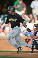 West Virginia center fielder Darren Ford (15) follows through on his swing versus Lexington at Applebee's Park in Lexington, KY, Thursday, June 7, 2007.