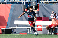FOXBOROUGH, MA - JULY 25: USL League One (United Soccer League) match. Ryan Spaulding #34 of New England Revolution II brings the ball forward during a game between Union Omaha and New England Revolution II at Gillette Stadium on July 25, 2020 in Foxborough, Massachusetts.