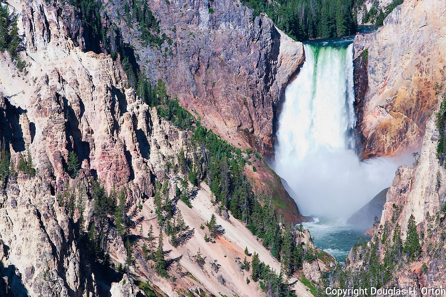 Lower Falls on the Yellowstone River in the Grand Canyon of the Yellowstone.  Look carefully for two men standing at the Brink viewpoint on the right of the falls!  At 308 feet, Lower Falls is the highest and most dramatic falls in the park.  Seen here from Artist Point.  Yellowstone National Park, the first National Park in the world, still enthrals over three million visitors a year with it's geothermal features,wildlife,  rugged mountains, deep canyons and stunning ecosystem.