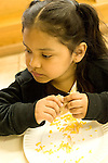 Education preschoool children ages 3-5 meal time lunch closeup of girl eating vertical