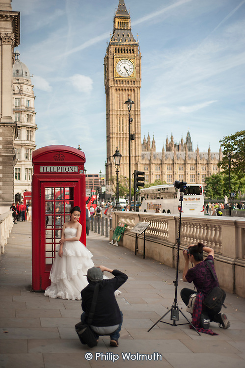 A Chinese bride pre-wedding photo-shoot with a red phone box & Big Ben, Parliament Square, London.