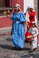 Antigua, Guatemala.  Participants Marching in Easter Sunday Resurrection Procession.  Semana Santa.