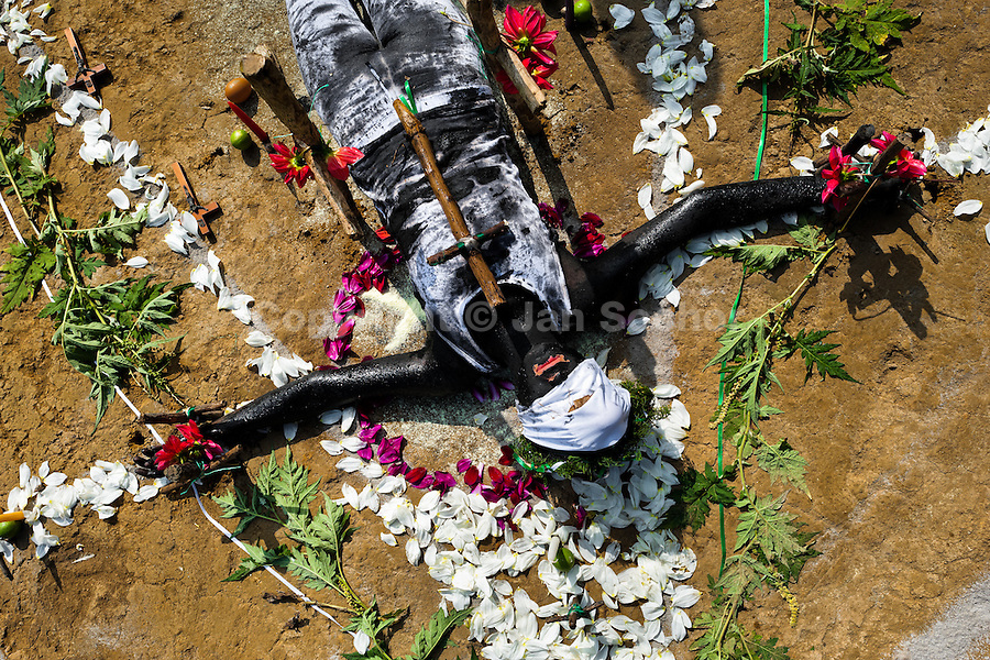 Diana R., who claims to be possessed by spirits, lies on the ground surrounded by flowers during a ritual of exorcism performed by Hermes Cifuentes in La Cumbre, Colombia, 28 May 2012. Exorcism is an ancient religious practice of evicting spirits, generally called demons or evil. Although the formal catholic rite of exorcism is rarely seen and must be only conducted by a designated priest, there are many pastors and preachers in Latin America performing exorcism ceremonies. The 52-year-old Brother Hermes, as the exorcist calls himself, claims to have been carrying out the healing rituals for more than 20 years. Using fire, dirt, candles, flowers, eggs and other natural-based items, in conjunction with Christian religous formulas, he attempts to drive the supposed evil spirit out of a victim's mind and body.