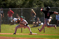 Dartmouth Big Green first baseman Michael Calamari (3) stretches for a throw as Keil Krumwiede (11) runs through the bag during a game against the Omaha Mavericks on February 23, 2020 at North Charlotte Regional Park in Port Charlotte, Florida.  Dartmouth defeated Omaha 8-1.  (Mike Janes/Four Seam Images)