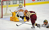 9 January 2009: University of Vermont Catamounts' goaltender Rob Madore, a Freshman from Venetia, PA, has one deflect just wide during the first game of a weekend series against the Boston College Eagles at Gutterson Fieldhouse in Burlington, Vermont. The Catamounts scored with one second remaining in regulation time to earn a 3-3 tie with the visiting Eagles. Mandatory Photo Credit: Ed Wolfstein Photo