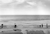 Italy. Marche Region. Ancona. Couples and single persons are looking at the Adriatic Sea. © 1987 Didier Ruef