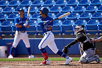 Toronto Blue Jays Santiago Espinal (5) bats during a Major League Spring Training game against the Pittsburgh Pirates on March 1, 2021 at TD Ballpark in Dunedin, Florida.  (Mike Janes/Four Seam Images)