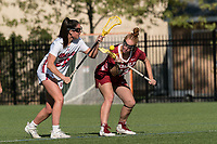 NEWTON, MA - MAY 14: Fiona McGowan #25 of University of Massachusetts and Belle Mastropietro #12 of Temple University face off during NCAA Division I Women's Lacrosse Tournament first round game between University of Massachusetts and Temple University at Newton Campus Lacrosse Field on May 14, 2021 in Newton, Massachusetts.