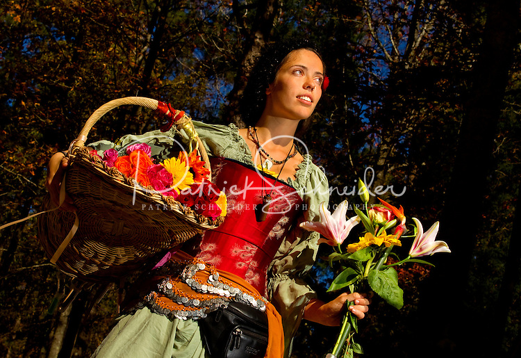 A costumed performer sells flowers at the annual Carolina Renaissance Festival in November 2011. The annual Renaissance Festival and Fair takes place each October and November in Huntersville, NC, near Charlotte, NC.