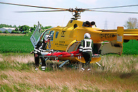 A road traffic accident involving a learner on a motorbike.  The air ambulance was moblized to the rta because the motorcyclist suffered severe head injuries. The paramedic crew are laoding the casualty onto the helicopter. They have stabliized the motorcyclist,  placing him on a spinal board and have put on a total neck brace prior to him being airlifted to hospital...© SHOUT. THIS PICTURE MUST ONLY BE USED TO ILLUSTRATE THE EMERGENCY SERVICES IN A POSITIVE MANNER. CONTACT JOHN CALLAN. Exact date unknown.john@shoutpictures.com.www.shoutpictures.com.