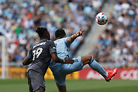 ST. PAUL, MN - AUGUST 21: Romain Metanire #19 of Minnesota United FC and Alan Pulido #9 of Sporting Kansas City battle for the ball during a game between Sporting Kansas City and Minnesota United FC at Allianz Field on August 21, 2021 in St. Paul, Minnesota.