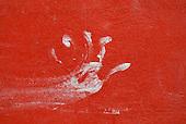 Aldeia Baú, Para State, Brazil. Smeared white hand print on a red wall.