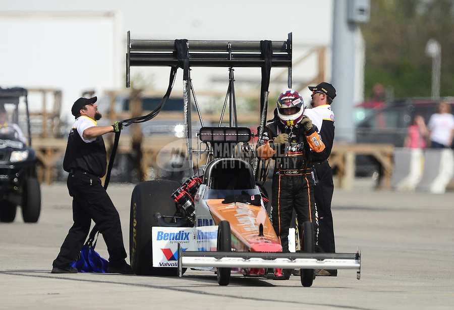 Sept. 30, 2012; Madison, IL, USA: NHRA Safety Safari members help top fuel dragster driver Clay Millican during the Midwest Nationals at Gateway Motorsports Park. Mandatory Credit: Mark J. Rebilas-