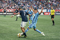 FOXBOROUGH, MA - SEPTEMBER 29: Heber #9 of New York City FC tackles Gustavo Bao #7 of New England Revolution during a game between New York City FC and New England Revolution at Gillettes Stadium on September 29, 2019 in Foxborough, Massachusetts.