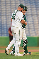 Tulane Green Wave catcher Luis Aviles (21) hands the game ball to pitcher Trent Johnson (42) after a game against the Houston Cougars on May 25, 2021 at BayCare Ballpark in Clearwater, Florida.  Tulane defeated Houston 4-1 in the opening game of the American Athletic Conference Tournament.  (Mike Janes/Four Seam Images)