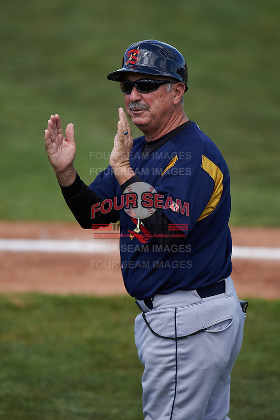 State College Spikes manager Johnny Rodriguez (18) jokes with fans during a game against the Batavia Muckdogs August 23, 2015 at Dwyer Stadium in Batavia, New York.  State College defeated Batavia 8-2.  (Mike Janes/Four Seam Images)