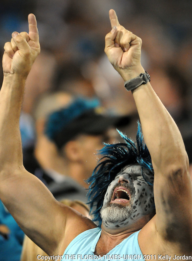 Kelly.Jordan@jacksonville.com -- 10/24/11-- A Jags fan celebrates in the stands during the 1st quarter. The Jacksonville Jaguars played against the Baltimore Ravens on EverBank Field in Jacksonville, FL on Monday October 24, 2011.   (The Florida Times-Union, Kelly Jordan)