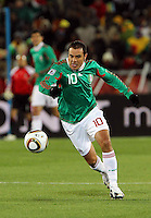 Cuauhtemco Blanco of Mexico in action against France.