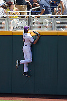 Louisiana State outfielder Mark Laird (9) climbs the wall reaching for a home run hit North Carolina Tar Heel catcher Brian Holberton in the first inning of Game 7 of the 2013 Men's College World Series on June 18, 2013 at TD Ameritrade Park in Omaha, Nebraska. The Tar Heels defeated the Tigers 4-2, eliminating LSU from the tournament. (Andrew Woolley/Four Seam Images)