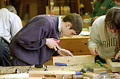 Trainer and trainees in the joinery workshop at Camden Training Centre, London.
