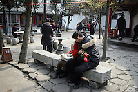CHINA. Hubei Province. Wuhan. Wuhan (population 4.3 million) is a sprawling city that sits on both sides of the Yangtze River. A couple in a temple. 2008.