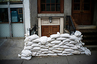 """NEW YORK, NY - AUGUST 4: A house entrance is blocked to prevent flooding at the South Street Seaport as city gets ready for tropical storm Isaias on August 4, 2020 in New York City. The Tri-State area """"New York, New Jersey and Connecticut"""" is preparing for torrential rain, strong winds from Tropical storm Isaias. (Photo by Eduardo MunozAlvarez/VIEWpress)"""