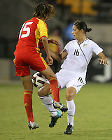Ali Krieger #16 of the USA WNT battles for the ball with Ling Sun #15 of the PRC WNT during an international friendly match at KSU Soccer Stadium, on October 2 2010 in Kennesaw, Georgia. USA won 2-1.