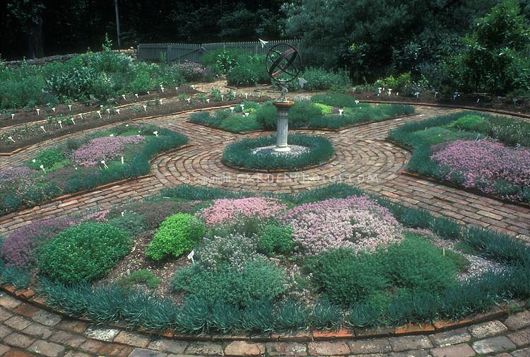 Circular symmetry formal herb garden with brick walkways, spherical sundial focal point, mix of herbs, thymes, etc