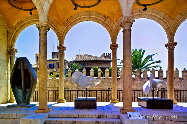 Sculptures, by Henry Moore and Francisco Barón, on a covered terrace of the Palau March (March Palace) museum, where the March Foundation's collection of modern sculpture can be seen. The piece on the left is by Henry Moore, titled 'Larhe Totem Head' and the untitled ones at centre and right are by Francisco Barón.