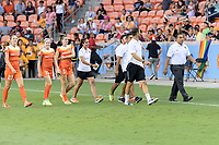 Houston, TX - Wednesday June 28, 2017: The Houston Dash coaching staff and reserves walking onto the pitch prior to a regular season National Women's Soccer League (NWSL) match between the Houston Dash and the Boston Breakers at BBVA Compass Stadium.