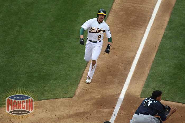 OAKLAND, CA - JUNE 15:  Jed Lowrie #8 of the Oakland Athletics runs home against the Seattle Mariners during the game at O.co Coliseum on Saturday June 15, 2013 in Oakland, California. Photo by Brad Mangin