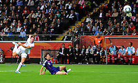 Abby Wambach (l) of team USA and Saki Kumagai of Japan during the FIFA Women's World Cup Final USA against Japan at the FIFA Stadium in Frankfurt, Germany on July 17th, 2011.
